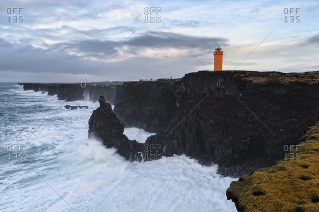 Lighthouse on a cliff above the ocean on the Snaefellsnes Peninsula in Iceland