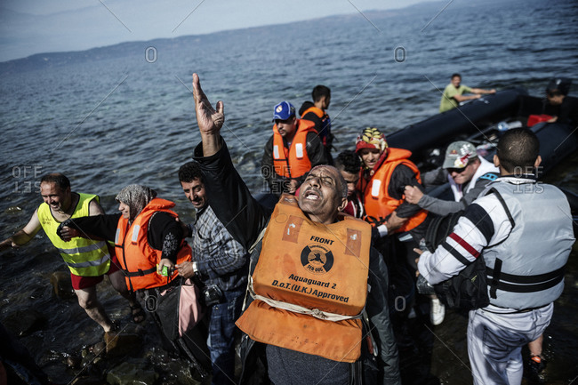 Lesbos, Greece - October 10, 2015: Refugees and migrants arriving on the Greek island of Lesbos after crossing the Aegean Sea from Turkey