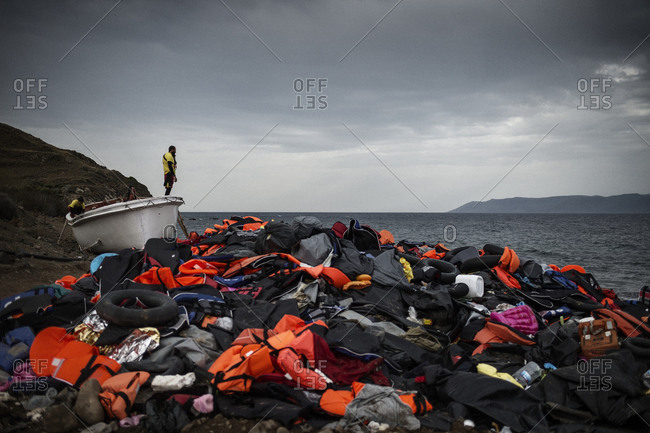 Lesbos, Greece - October 11, 2015: A pile of debris left by refugees on a beach on the Greek island of Lesbos after crossing the Aegean Sea from Turkey