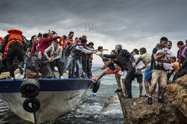 Lesbos, Greece - October 11, 2015: Refugees and migrants arriving on the Greek island of Lesbos after crossing the Aegean Sea from Turkey
