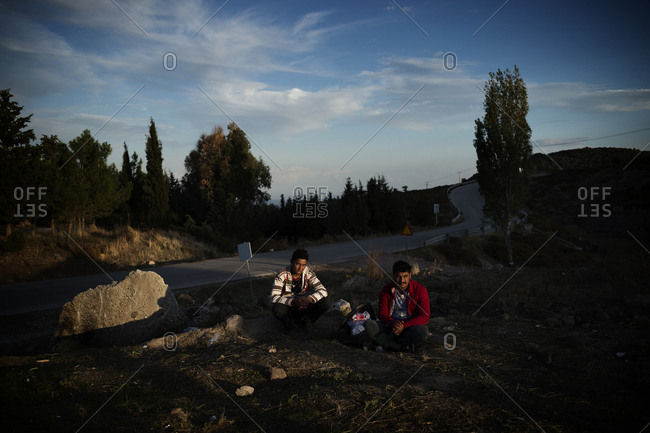 Lesbos, Greece - October 12, 2015: Migrants waiting in the Mantamados refugee camp on the Greek island of Lesbos after crossing the Aegean Sea from Turkey