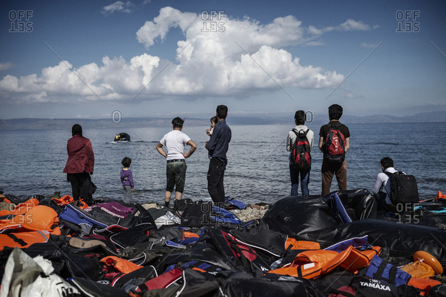 Lesbos, Greece - October 13, 2015: Refugees and migrants arriving on the Greek island of Lesbos after crossing the Aegean Sea from Turkey