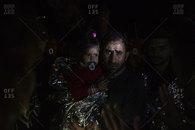 Lesbos, Greece - October 14, 2015: Refugees and migrants arrive in the night on the Greek island of Lesbos after crossing the Aegean Sea from Turkey