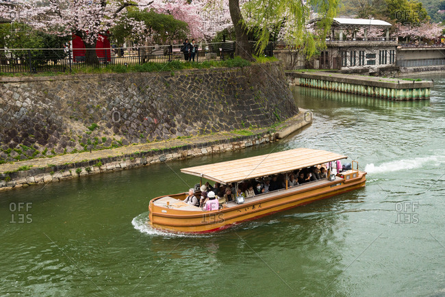 Kyoto, Japan - April 2, 2016: A riverboat on a sightseeing tour in Japan