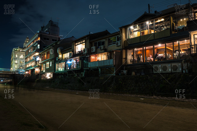 Kyoto, Japan - April 2, 2016: Row of illuminated buildings along a canal in Japan