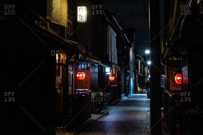 Kyoto, Japan - April 2, 2016: A long narrow street at night in Japan