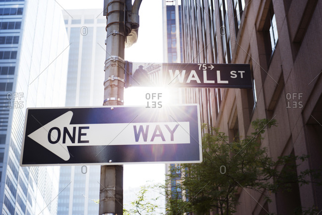 Street sign of Wall St and a one way sign, New York City, NY