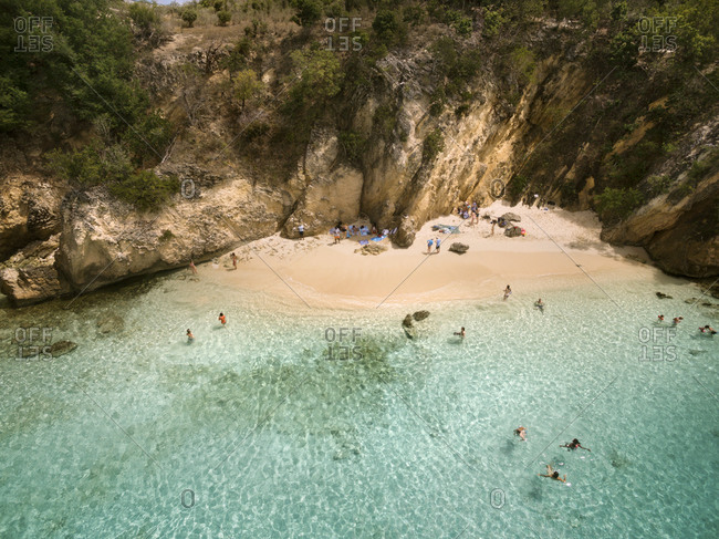 Swimmers on secluded beach