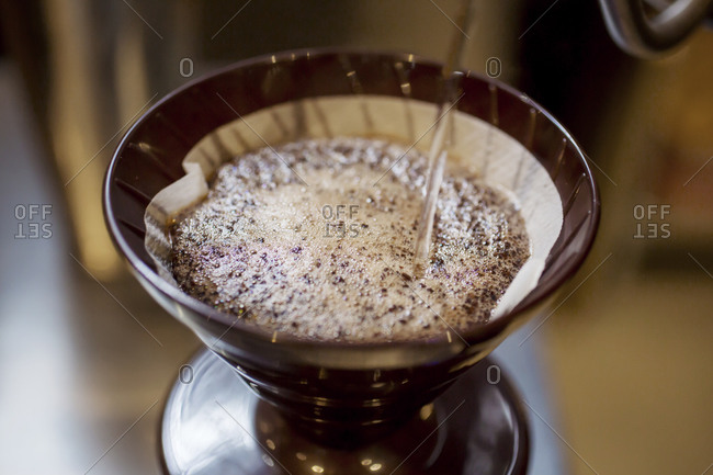 Hot water being poured over a drip coffee maker