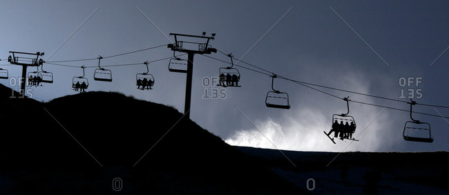 Panoramic view of the ski lifts and a snow machine blowing snow at Coronet Peak, Queenstown,  South Island, New Zealand