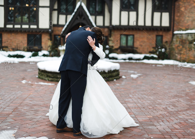 Bridal couple in winter courtyard