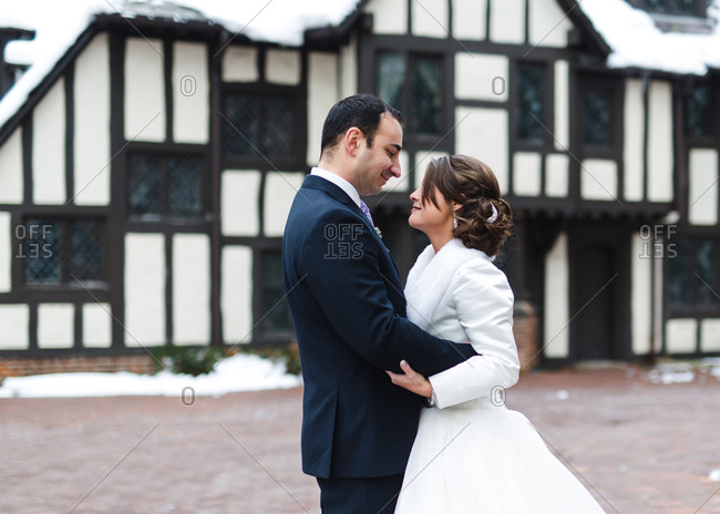 Bridal couple in a winter courtyard