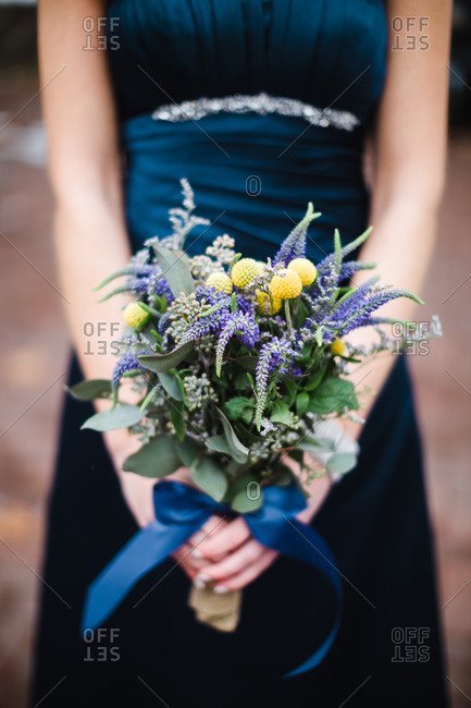 Flowers held in bridesmaid's hands