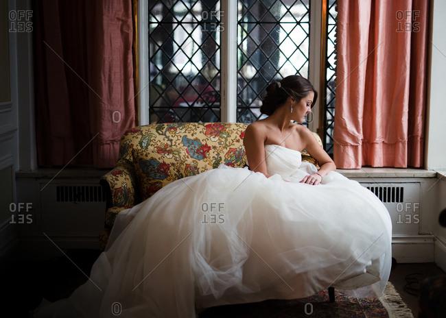 Bride sitting on a loveseat