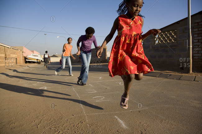 Children playing hopscotch in the street