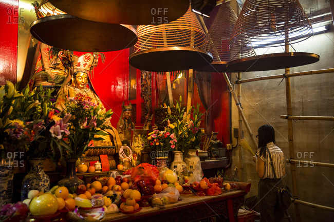 Woman praying at Man Mo temple, Hong Kong