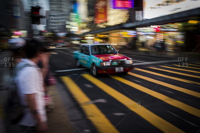 Taxi passing by at Nathan Road, Hong Kong