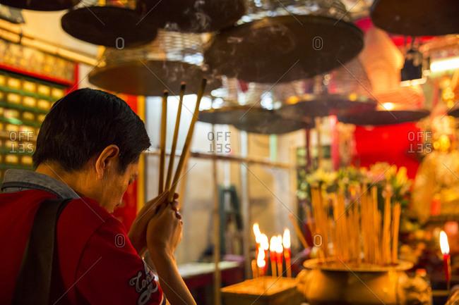 September 13, 2015: Man praying at Man Mo temple, Hong Kong