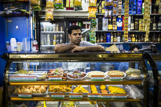 September 14, 2015: Indian worker from Kolkata managing a grocery store inside Chunking Mansions, Hong Kong