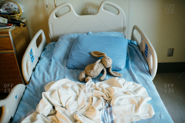 Stuff bunny in an empty hospital bed
