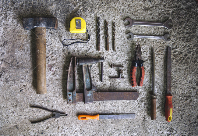 Still life of various tool arranged on concrete background