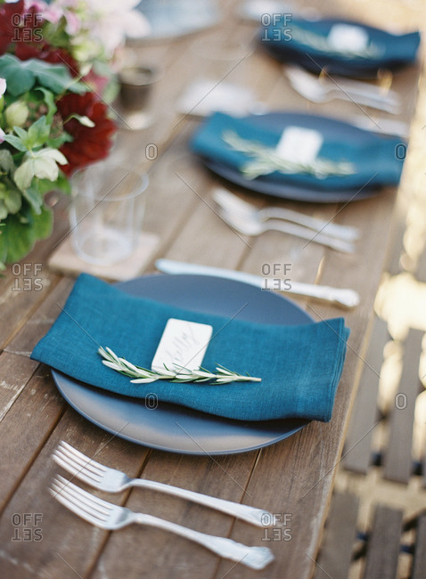Blue table setting on a wooden table