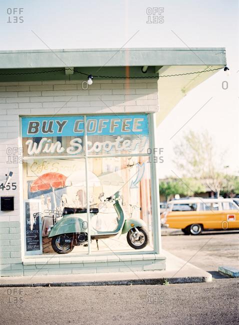 Petaluma, California, USA - March 25, 2016: Cafe window display to win a scooter