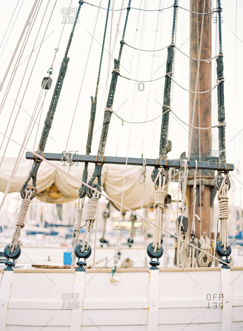 Rope ladder and mast on a white wooden sail boat