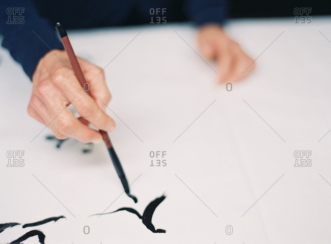 Hand writing Chinese characters in calligraphy