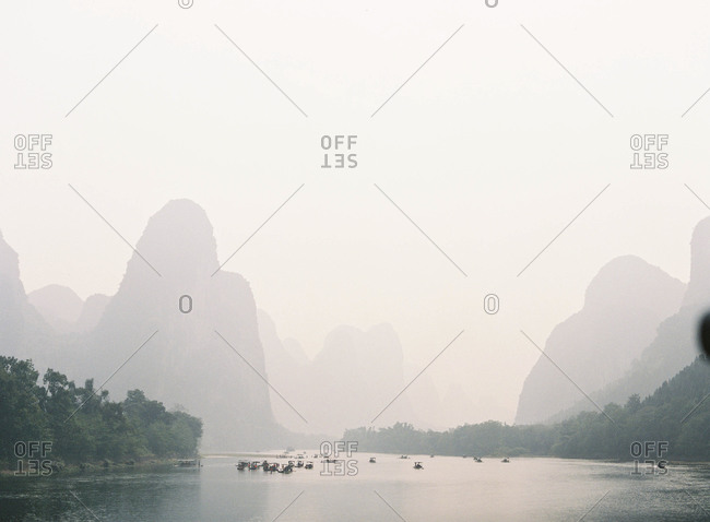 Boats in the distance at Li River in the morning