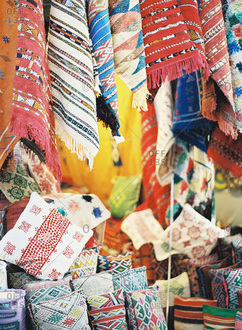 Textile display at a market stall in Morocco