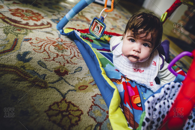 Portrait of a baby playing on the floor