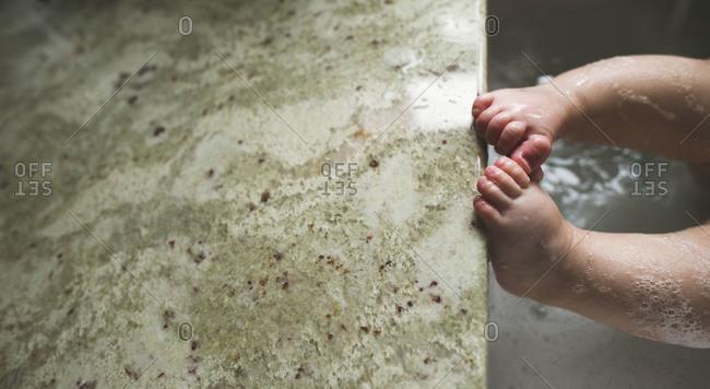 Baby feet in the bath