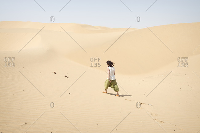 Man walking alone in the desert
