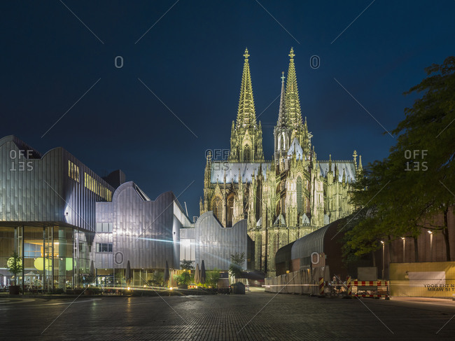 Cologne, Germany - August 3, 2015: View to lighted Cologne Cathedral and Museum Ludwig in the foreground