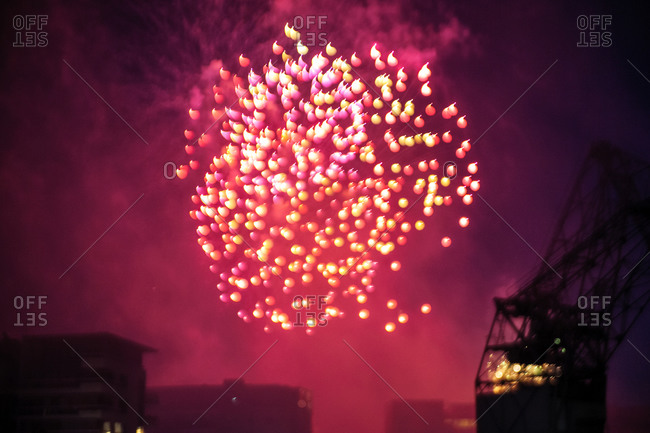 Fireworks display over industrial area
