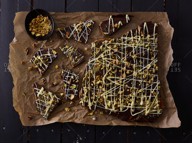 Pieces of chocolate nut bark on brown paper