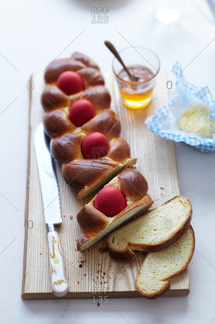 Braided bread with Easter eggs cut into slices