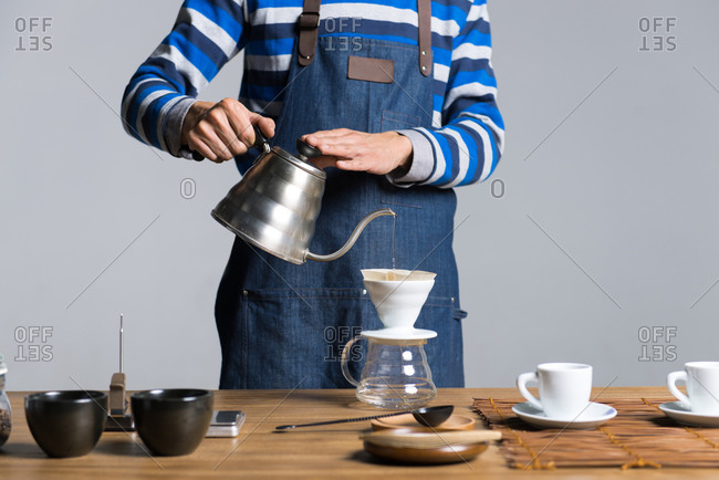 Man making coffee with filter coffee maker