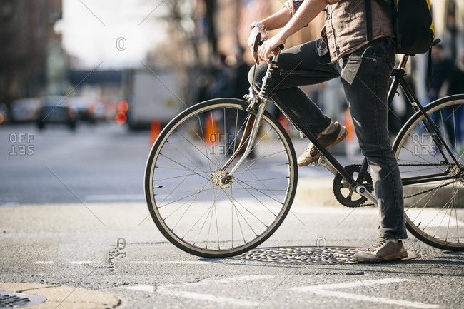 Man riding a fixed gear bicycle in the city