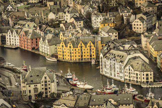 January 26, 2016: Traditional residential buildings lining a waterway in Alesund, Norway