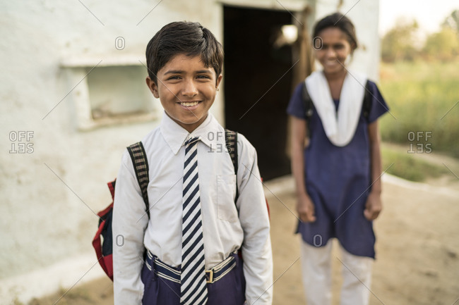 March 2, 2016: Brother and sister getting ready to head to school in India