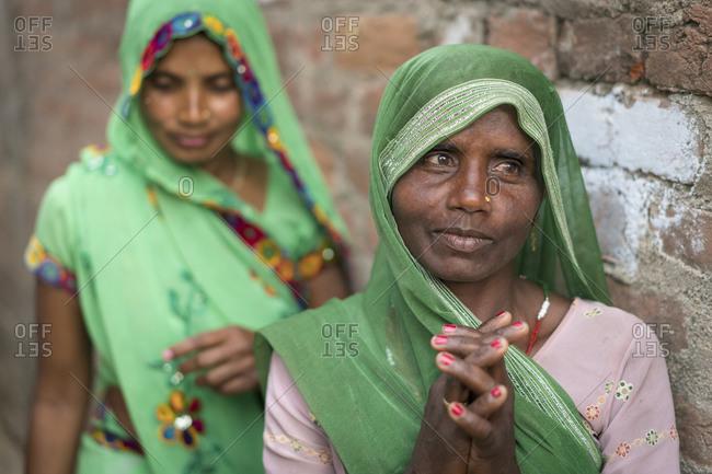 March 4, 2016: Portrait of Indian women in green saris