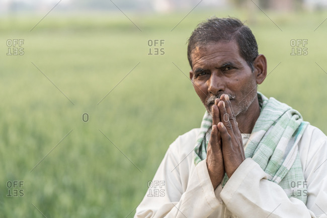 March 5, 2016: Portrait of an Indian man raising his hands in a  Namaste gesture
