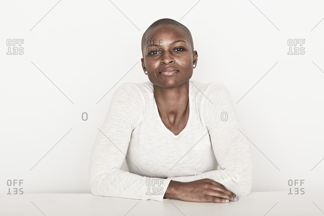 Woman with folded arms on table