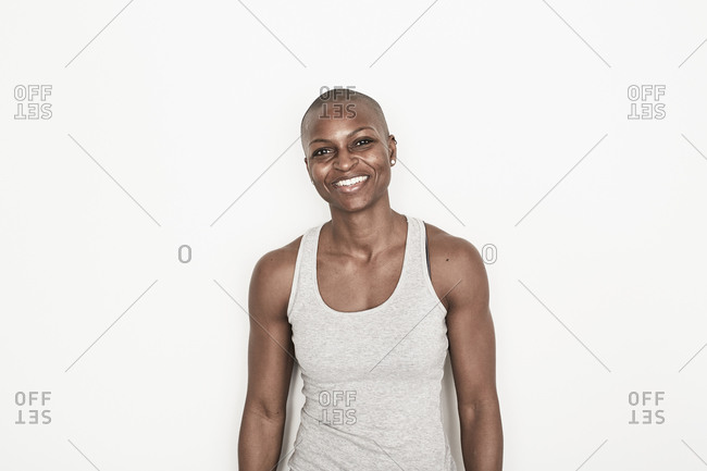 A young woman smiling in a gray tank top