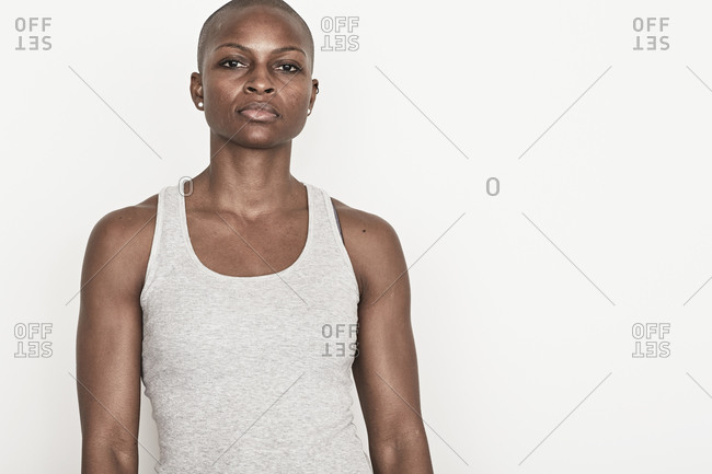 A confident woman in a tank top