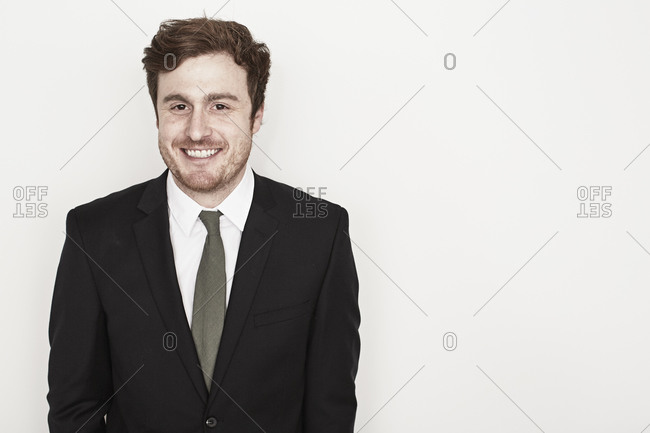 Young man laughing in suit