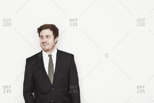 Man standing in suit smiling