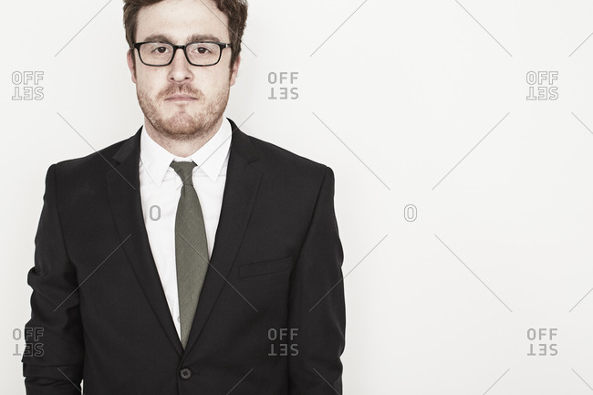 Portrait of a man in suit and glasses